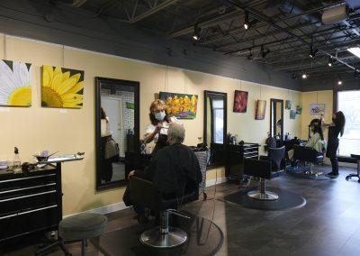 Hair stylist cutting the hair