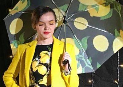 Girl holding umbrella with lemon print