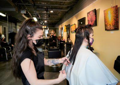 Stylist cutting the hair