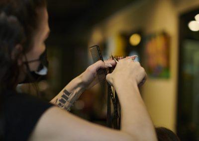 Female stylist cutting the hair